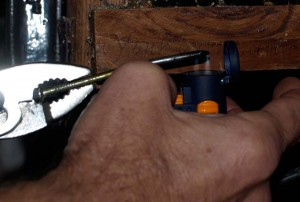 Use a hot poker to sear a new hole for securing the power strap to the spine of the cuff.