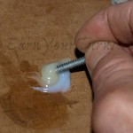 Mix up a slow-cure epoxy to bond the inserts.