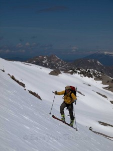 Matt J skinning up Lassen with Mt. Shasta behind.