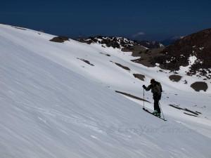 Mt. Shasta lingers beyond as Lynnzilla skins up Lassen's NE corner.