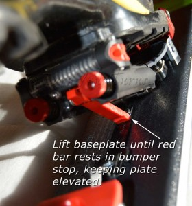 To step in, first cock the baseplate into position by lifting it until the red bar seats in the bumper.