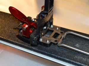 To access the rear mounting holes the baseplate must be partially disassembled.  Hint: When reassembling, it is easier to thread the spring knobs on when the baseplate is flat.