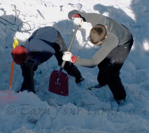 Two of Team MSR dig furiously to rescue a dummy buried 0.8m deep.