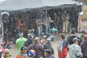 The band promised to play; rain, snow or shine.