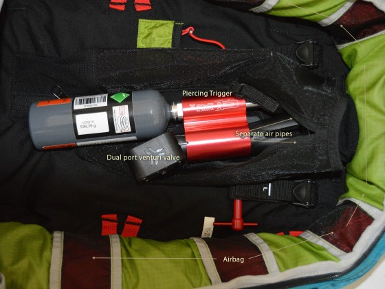 A smaller canister and dual port venturi valve rest in the center of the main compartment with a mesh cover and two conjoined airbags that wrap around the sides.